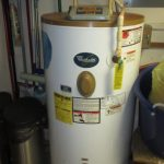 Rusted water heater. Replacement is needed.